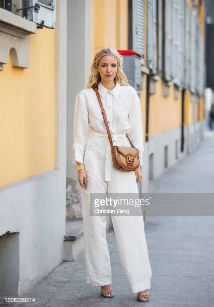 Leonie Hanne is seen wearing white button shirt and pants brown bag outside Etro during Milan Fashion Week Fall/Winter 20202021 on February 21 2020...