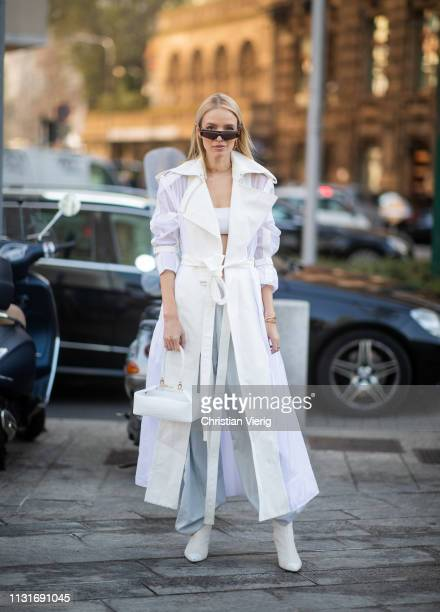 Leonie Hanne is seen wearing white coat outside Sportmax on Day 3 Milan Fashion Week Autumn/Winter 2019/20 on February 22 2019 in Milan Italy