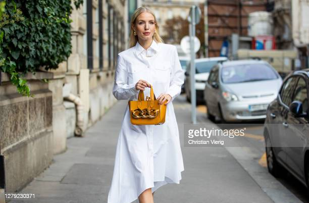 Leonie Hanne is seen wearing white J.W. Anderson blouse dress, J.W. Anderson bag during a Street Style Fashion Photo Session on October 08, 2020 in...