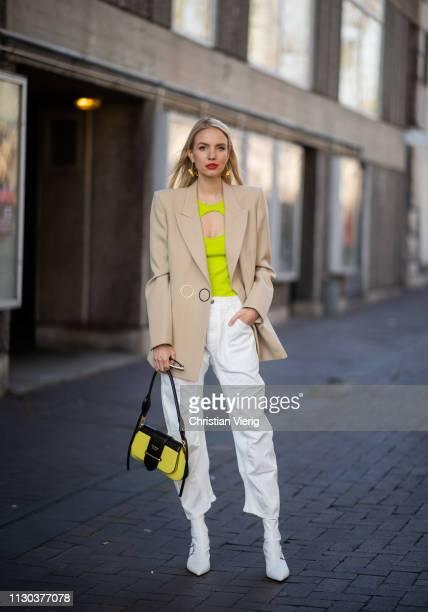 Leonie Hanne is seen wearing white pants Prada bag beige blazer outside Roland Mouret during London Fashion Week February 2019 on February 17 2019 in...
