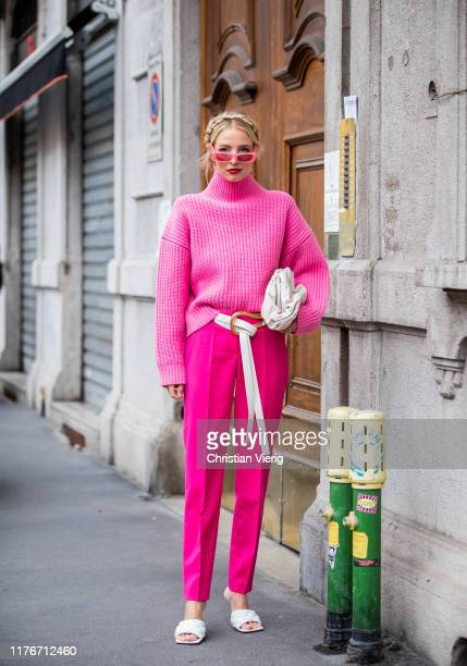 Leonie Hanne is seen wearing white pouch bag and sandals Bottega Veneta pink turtleneck knit white belt pink pants sunglasses outside Boss during...