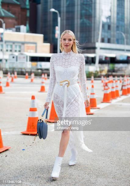 Leonie Hanne is seen wearing white sheer dress during New York Fashion Week September 2019 on September 09, 2019 in New York City.