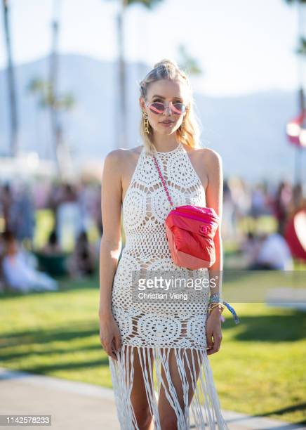 Leonie Hanne is seen wearing white sheer dress with fringes, red bag at the Revolve Festival during Coachella Festival on April 13, 2019 in La...