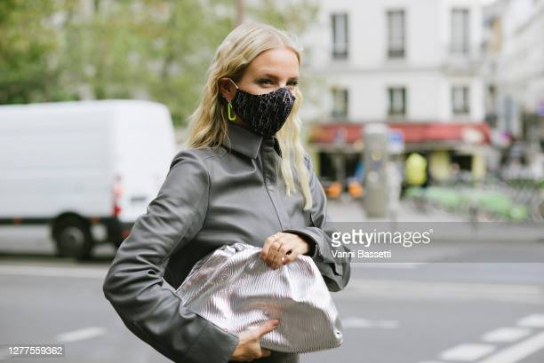 Leonie Hanne poses wearing a Dior mask after the Gauchere show at the Espace Commines during Paris Fashion Week - Womenswear Spring summer 2021 on...