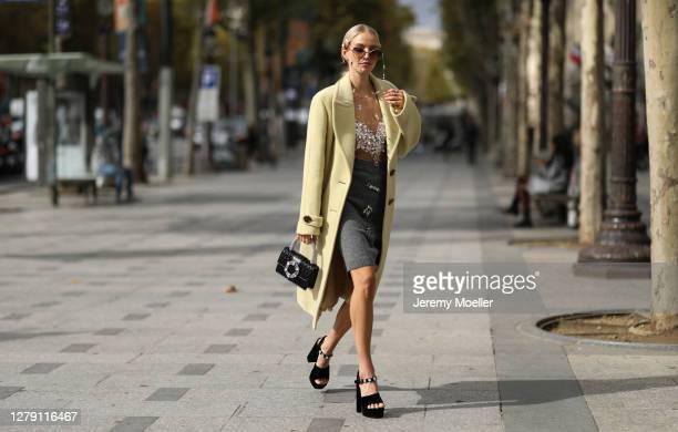 Leonie Hanne seen wearing a complete Miu Miu look outside Miu Miu during Paris Fashion Week - Womenswear Spring Summer 2021 : Day Nine on October 06,...