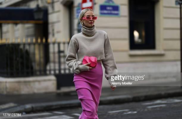 Leonie Hanne seen wearing a Gucci shades, Bottega Veneta bag and heels, purple skirt during Paris Fashion Week - Womenswear Spring Summer 2021 : Day...