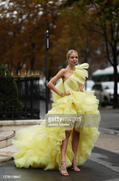 Leonie Hanne seen wearing a yellow Georges Hobeika dress and Chanel earrings during Paris Fashion Week - Womenswear Spring Summer 2021 : Day Nine on...