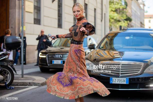 Leonie Hanne seen wearing belted dress with print outside the Etro show during Milan Fashion Week Spring/Summer 2020 on September 20 2019 in Milan...
