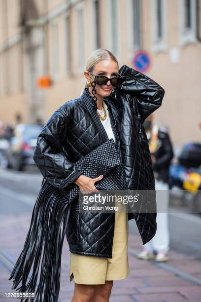 Leonie Hanne seen wearing black jacket, clutch, shorts, heels, sunglasses with chain outside Philosophy during the Milan Women's Fashion Week on...