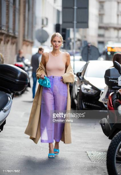 Leonie Hanne seen wearing body, Bottega Veneta metallic mini pouch, pink sheer pants outside the Blumarine show during Milan Fashion Week...