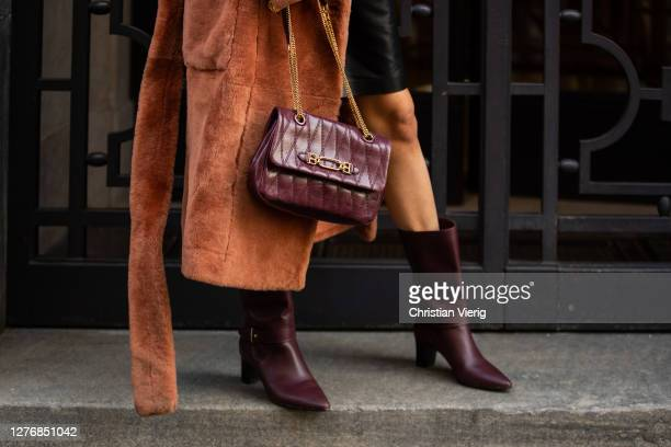 Leonie Hanne seen wearing bordeaux bag and boots, coat outside Bally during the Milan Women's Fashion Week on September 26, 2020 in Milan, Italy.