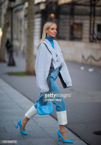 Leonie Hanne seen wearing cuffed denim jeans, cardigan, blue turtleneck, Prada bag and heels outside Zuhair Murad during Paris Fashion Week - Haute...