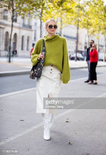 Leonie Hanne seen wearing green turtleneck knit Givenchy bag creme white skirt with slit white boots outside Beautiful People during Paris Fashion...