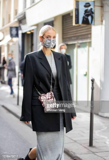 Leonie Hanne seen wearing grey dress, black blazer, bag, black boots outside Paco Rabanne during Paris Fashion Week - Womenswear Spring Summer 2021 :...