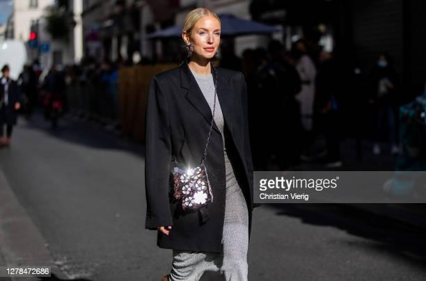 Leonie Hanne seen wearing grey dress, black blazer, bag outside Paco Rabanne during Paris Fashion Week - Womenswear Spring Summer 2021 : Day Seven on...