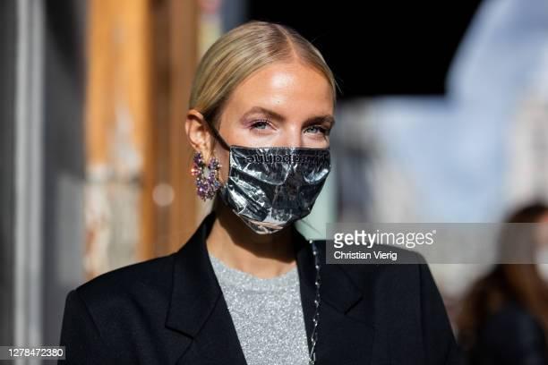 Leonie Hanne seen wearing grey dress, black blazer, face mask, earrings outside Paco Rabanne during Paris Fashion Week - Womenswear Spring Summer...