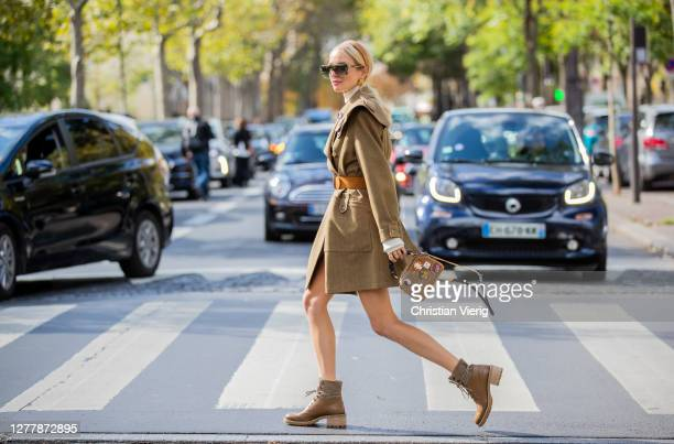 Leonie Hanne seen wearing khaki belted coat, bag, boots outside Chloe during Paris Fashion Week - Womenswear Spring Summer 2021 : Day Four on October...