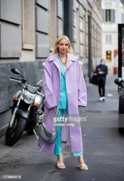 Leonie Hanne seen wearing pink coat, turquoise suit, bag, white heels outside Boss during the Milan Women's Fashion Week on September 25, 2020 in...