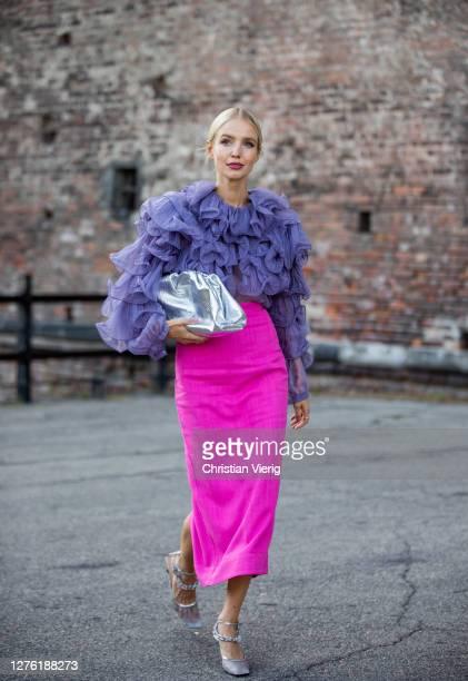 Leonie Hanne seen wearing purple top and pink skirt, silver Bottega Veneta bag outside Alberta Ferretti during the Milan Women's Fashion Week on...