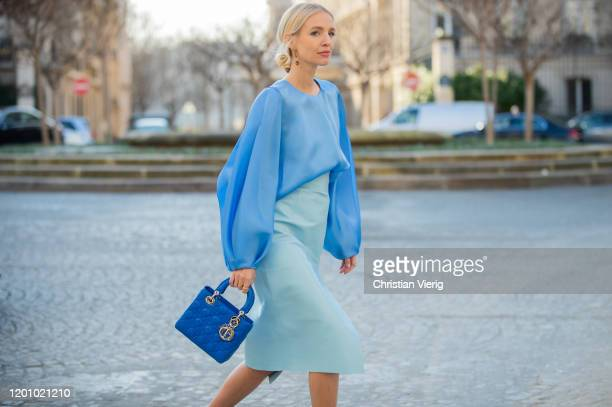 Leonie Hanne seen wearing sheer blue Dior blouse, light blue skirt, Lady Dior bag during Paris Fashion Week - Haute Couture Spring/Summer 2020 on...