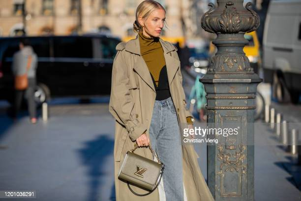 Leonie Hanne seen wearing trench coat, Louis Vuitton bag, denim jeans during Paris Fashion Week - Haute Couture Spring/Summer 2020 on January 21,...