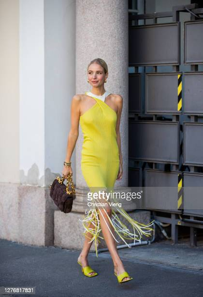 Leonie Hanne seen wearing yellow dress with fringes, bag, heels outside Ports 1961 during the Milan Women's Fashion Week on September 26, 2020 in...
