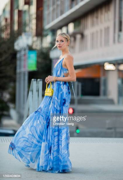 Leonie Hanne seen wearing yellow mini bag, blue dress with graphic print outside Jacquemus during Paris Fashion Week - Menswear F/W 2020-2021 on...