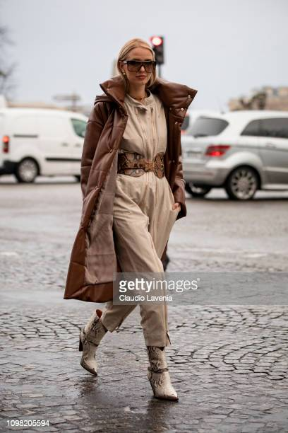 Leonie Hanne wearing a beige jumpsuit brown snake print leather belt beige boots Louis Vuitton bag and brown long jacket is seen outside Alexandre...