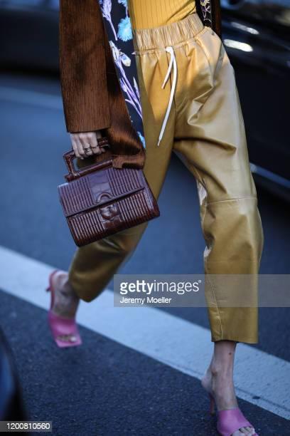 Leonie Hanne wearing a Chloe bag, Givenchy top, Gucci shades and Schiaparelli blazer before Schiaparelli on January 20, 2020 in Paris, France.