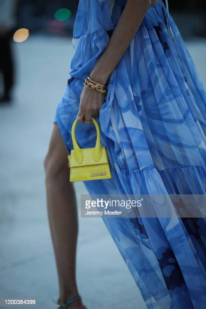 Leonie Hanne wearing a Jacquemus dress and yellow mini bag before the Jacquemus Men Fashion Show AW20 on January 18, 2020 in Paris, France.