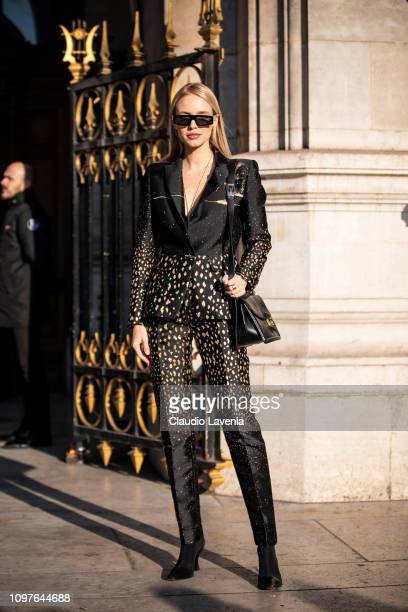Leonie Hanne wearing a printed black suit black heels and black bag is seen outside Schiaparelli during Paris Fashion Week Haute Couture Spring...