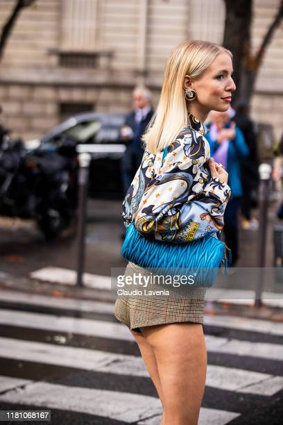 Leonie Hanne, wearing a printed blouse, checked shorts and light blue bag, is seen outside the Miu Miu show during Paris Fashion Week - Womenswear...