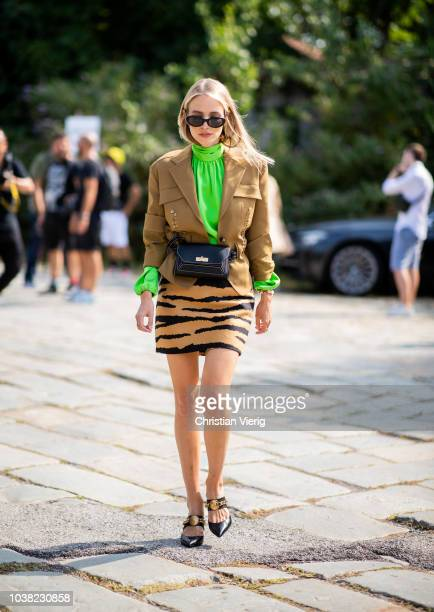 Leonie Hanne wearing animal print skirt is seen outside Roberto Cavalli during Milan Fashion Week Spring/Summer 2019 on September 22 2018 in Milan...