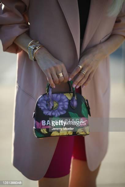 Leonie Hanne wearing Balenciaga bag, Frankie Shop blazer, Skims top, Nanushka pants and Fendi watch on June 21, 2020 in Hamburg, Germany.