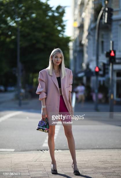 Leonie Hanne wearing Bottega Veneta heels Balenciaga bag Frankie Shop blazer Skims top Nanushka pants and Fendi watch on June 21 2020 in Hamburg...