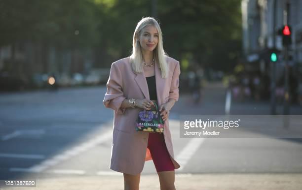 Leonie Hanne wearing Bottega Veneta heels, Balenciaga bag, Frankie Shop blazer, Skims top, Nanushka pants and Fendi watch on June 21, 2020 in...