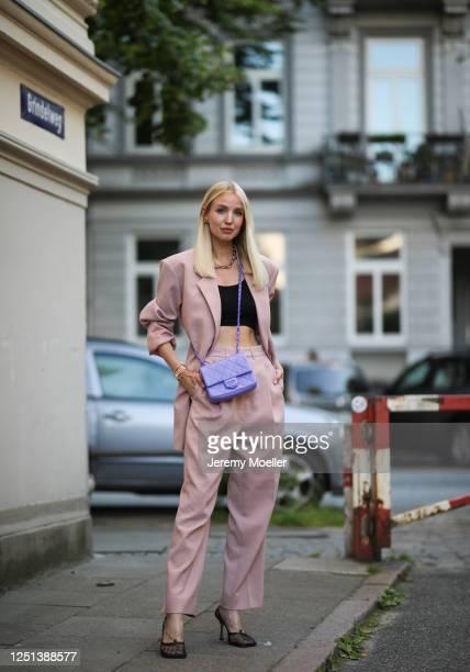 Leonie Hanne wearing Chanel bag, Bottega Veneta heels, The Frankie Shop suit, Skims black top and Fendi watch on June 21, 2020 in Hamburg, Germany.