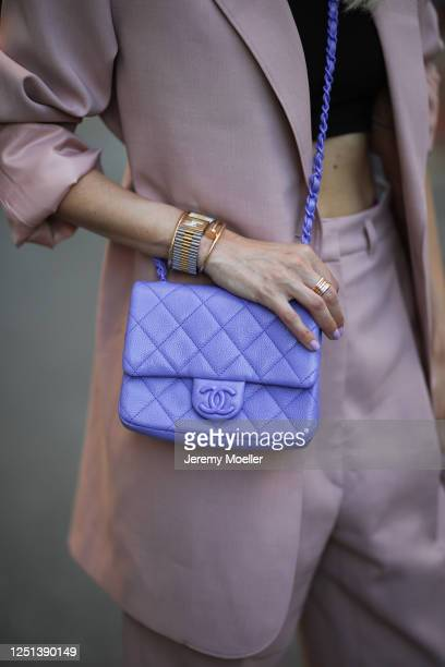 Leonie Hanne wearing Chanel bag, The Frankie Shop suit, Skims black top and Fendi watch on June 21, 2020 in Hamburg, Germany.