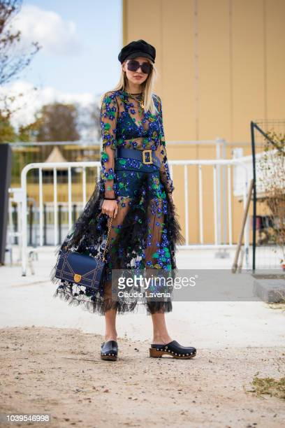 Leonie Hanne, wearing Dior seethrough dress with flower embroidery, is seen before the Christian Dior show, on September 24, 2018 in Paris, France.