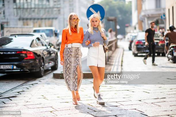 Leonie Hanne wearing orange long shirt high waist skirt with slit and snake print is seen outside Sportmax during Milan Fashion Week Spring/Summer...