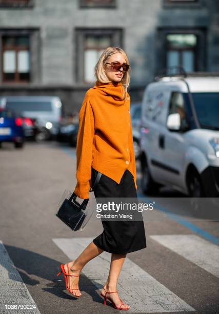 Leonie Hanne wearing orange wrapped knit is seen outside Max Mara during Milan Fashion Week Spring/Summer 2019 on September 20 2018 in Milan Italy