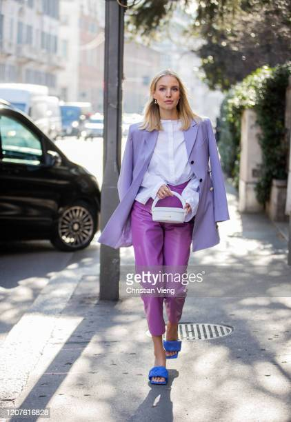 Leonie Hanne wearing purple pants, lavender blazer, white Jacquemus bag, Bottega sandals outside Max Mara during Milan Fashion Week Fall/Winter...