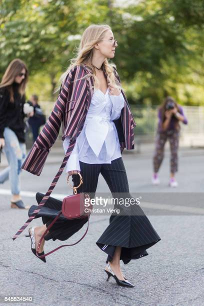 Leonie Hanne wearing stripped jacket flared pants Chloe bag Dior sling backs seen in the streets of Manhattan outside Zimmermann during New York...