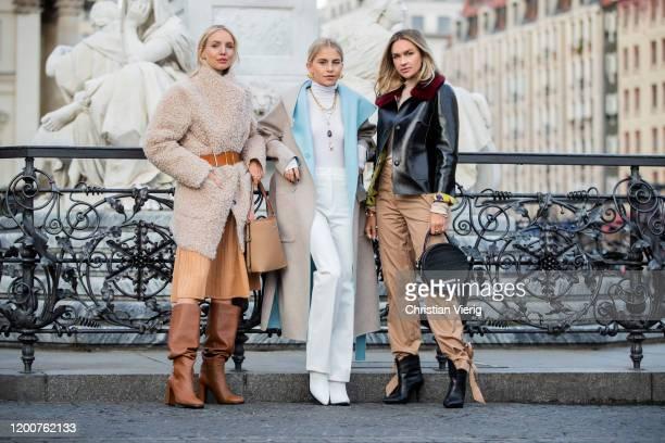 Leonie Hanne wearing total look Marc Cain: beige teddy coat, orange brown belt, pleated skirt, brown boots and bucket bag, Caroline Caro Daur seen...
