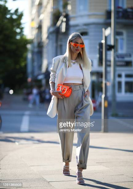 Leonie Hanne wearing Valentino bag, Gucci shades, Off white top, Amina Muaddi heels, Storets blazer and Frankie Shop pants on June 21, 2020 in...