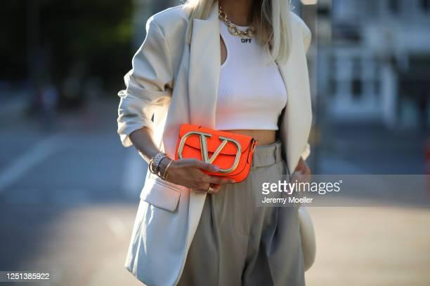 Leonie Hanne wearing Valentino bag, Off white top, Storets blazer and Frankie Shop pants on June 21, 2020 in Hamburg, Germany.