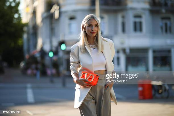 Leonie Hanne wearing Valentino bag, Off white top, Storets blazer and Frankie Shop pants on June 21, 2020 in Hamburg, Germany.