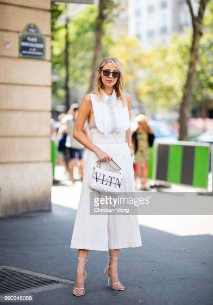 Leonie Hanne wearing white Valentino bag is seen outside Ralph Russo on day two during Paris Fashion Week Haute Couture FW18 on July 2 2018 in Paris...