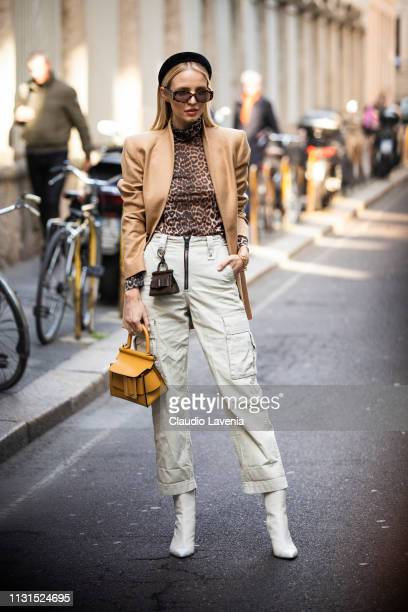 Leonie Hanne wearing yellow bag camel coat and animal print tshirt is seen outside Blumarine on Day 3 Milan Fashion Week Autumn/Winter 2019/20 on...
