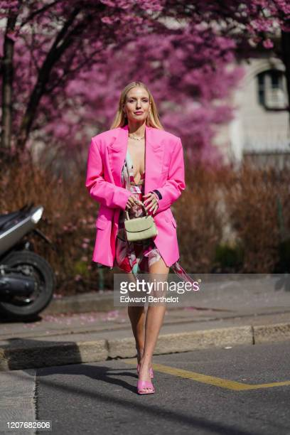 Leonie Hanne wears a neon pink oversized blazer jacket, a bag, pink shoes, outside Koche x Pucci, during Milan Fashion Week Fall/Winter 2020-2021 on...